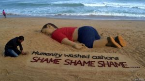 Indian artist Sudarsan Pattnaik created a sand sculpture of the image of Alan Kurdi's body. Photo courtesy of Getty Images